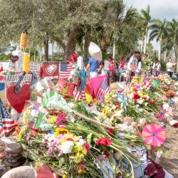 Visitors observe the memorial outside MSD. Photo by Suzanna Barna