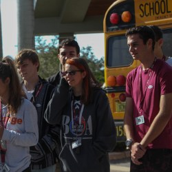 Seniors Jessica Frengut, Maddy King, Nathan Louis, Erich Cook and Michael Robb check in to vote at the Parkland Recreational Center on Thursday, Nov. 1. Eligible seniors were  transported to the polls to vote for the first time as part of a Broward County Public Schools initiative to engage young voters. Photo by Rebecca Schneid