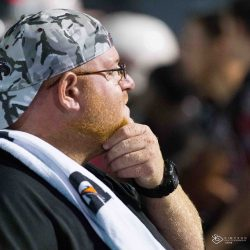 For Feis. Coach Aaron Feis watches a Varsity football team game from the sidelines. The guardian program was named after Feis, who died after rushing to aide students and teachers as a shooting unfolded on Feb. 14, 2018 at Marjory Stoneman Douglas High School. Photo courtesy of Sean Simpson