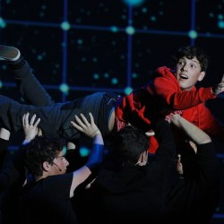 """Logan Webber, who plays the lead role of Holden _______ in the play, """"The Curious Incident of a Dog in the Nightime flies across the stage. Photo by Nyan Clarke"""