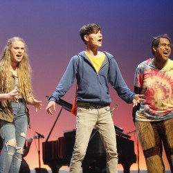 """Electrifying Performance. Juniors Isabela Barry, Tanzil Philip and senior Alexander Athanasiou perform in Douglas Drama's production of the concert version of """"The Lightning Thief"""" on April 26. Photo by Mackenzie Quinn"""