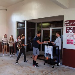 Fashionably Late. Students come late to school and have to line up to get tardy passes before heading to class in the morning. The new tardy policy requires students to get a pass to class, if they are not in class by 7:40 a.m. Photo by Darian Williams