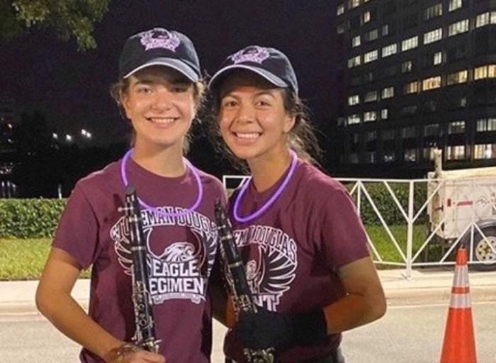 Juniors Alexa Palen and Marianna Gutierrez smile in uniform for their Waterford 5k performance. Photo courtesy of Marianna Gutierrez.