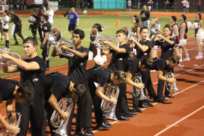 Band members perform the annual Guillotine exercise. Photo by Travis Newbery