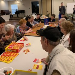 """DECA students and Aston Gardens residents participate in games for their chapter project """"Connecting the Generations."""""""