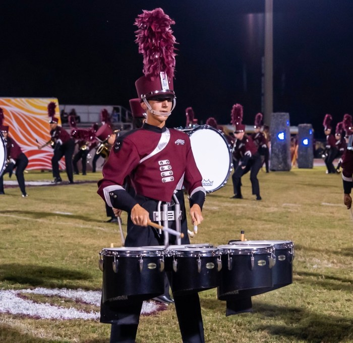 "Junior Asher Perez plays on the tenor drums for the 2019-2020 Eagle Regiment marching band show ""Winter's End."" Photo courtesy of the Eagle Regiment Facebook page"