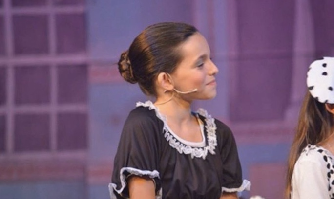 Young Harris performing in 101 Dalmatians, one of her first stage adaptations.