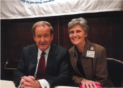 Eunie Smith with Pat Buchanan at an Eagle Council meeting.