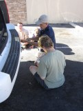 Changing a flat tire on our rental car on the way to the Phoenix airport.