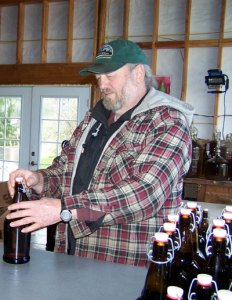 Jim Davis bottling cider.