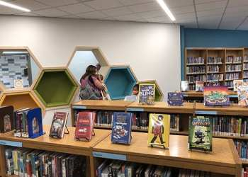 Patrons browse the LPL children's room with social distancing and face coverings on the first day of the LPL Express Visits program. (2020)