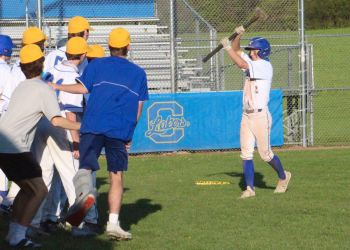 Cazenovia infielder Jack Byrnes (right) joins his teammates in celebrating his home run in last Tuesday's game against Hannibal. It was the first home run of the season for the Lakers, who won 12-2 and then topped the Warriors  13-1 a day later.