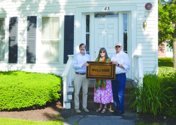 Cazenovia College Executive Vice President David Bergh, left, holds out the welcome mat at 43 Linckaen St., the college-owned, campus house being renovated as a suitable home for New American families to resettle in the village. With him are Carolyn Holmes, center, and David Holmes, of Cazenovia Welcomes Refugees (CWR). CWR is a partner in the effort along with InterFaith Works of Central New York. On June 19, Cazenovia Welcomes Refugees (CWR) celebrated World Refugee Day at the Cazenovia Farmers' Market. (Submitted)