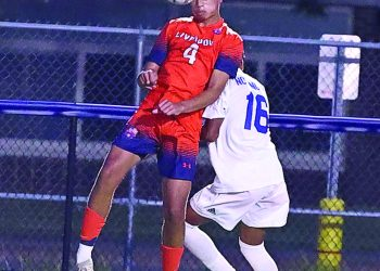 Liverpool freshman midfielder Christian Hope (4) goes up for a header during last Wednesday's game against Nottingham. The Warriors lost 2-1 to the Bulldogs.