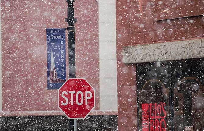 A heavy fall of snow almost obscures signs in historic downtown The Dalles yet again Wednesday afternoon. This winter has seen the 38-year-old record for continuous days of snow on the ground more than doubled.