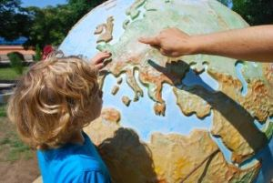 A grandchild learning about the globe