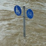 Sign visible, part of post below flood water