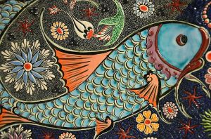 Mosaic of a fish and other designs