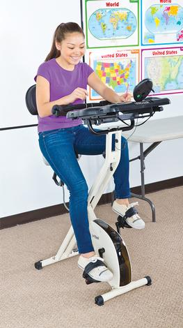 LETS MOVE Students use fit desks to exercise while
