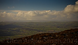 Directly west. Carnedd Llewellyn (1064 metres) can be seen left of centre, over 30 miles away. Again, zoomed in a little
