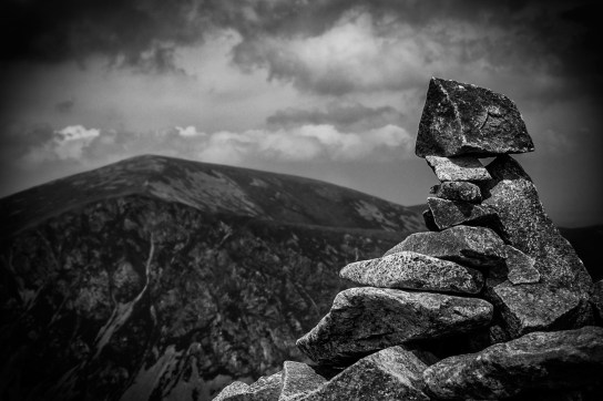 Precariously balanced stone with Mynydd Mawr rear