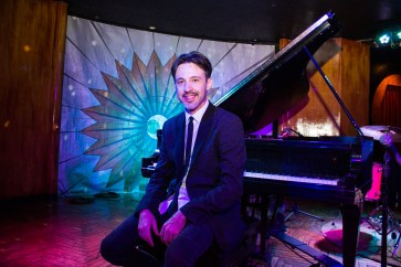 Matthew Ball at a piano