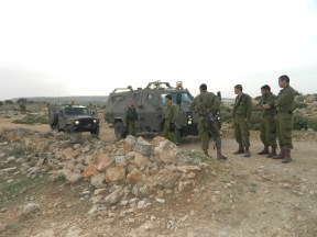 The Israeli army arrives after Israeli settlers spotted our group walking on Ziat's land. Photo EAPPI/L. Hilton.