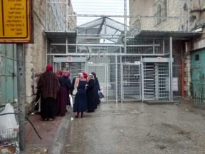 31.12.15 Hebron, CP 56 Teacher waiting to cross. Photo EAPPI/M. Botelho