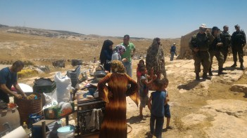 19.06.16 Residents next to belongings retrieved from homes prior to demolitions. Photo. N. Nawaja
