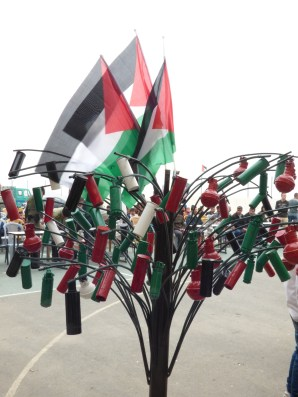Tree made by out of Tear Gas Canisters and Sound Bomb Shells by pupils of Urif School Photo EAPPI/E. Pritchard, 09.04.15