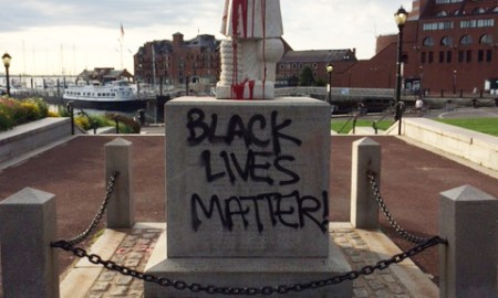 Columbus Statue Was Vandalized With Red Paint & Tagged With Black Lives Matter