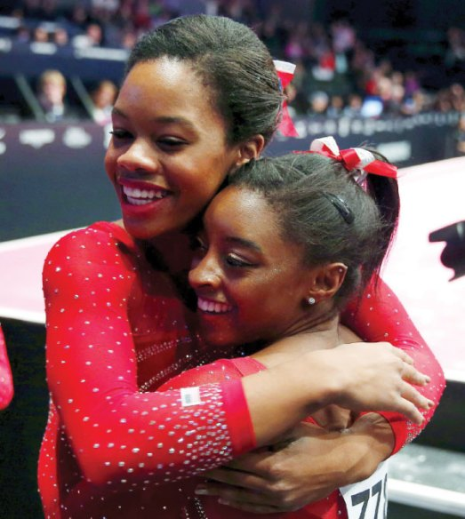 Simone Biles Wins World Gymnastics Championship For The Third Time & Gabby Douglas Wins 2nd Place