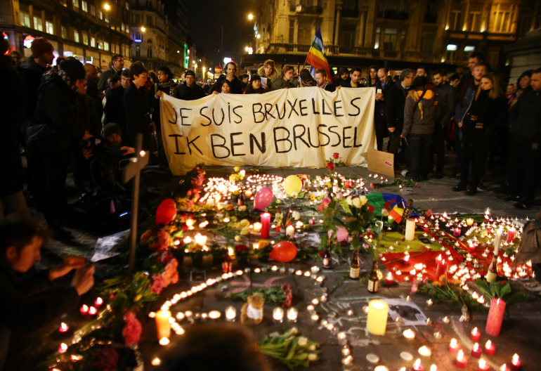 BRUSSELS, BELGIUM - MARCH 22:  People hold up a banner as a mark of solidarity at the Place de la Bourse following today's attacks on March 22, 2016 in Brussels, Belgium. At least 31 people are thought to have been killed after Brussels airport and a Metro station were targeted by explosions. The attacks come just days after a key suspect in the Paris attacks, Salah Abdeslam, was captured in Brussels.  (Photo by Carl Court/Getty Images)