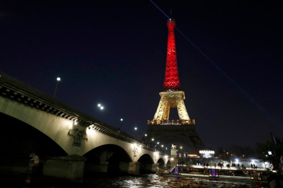 The Eiffel Tower in Paris paying Tribute to the victims in Brussels attack with the tower showing off the colors of the Belgian flag. Photo Credit: Google