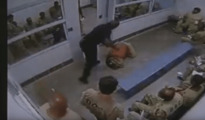 guard beats up inmate