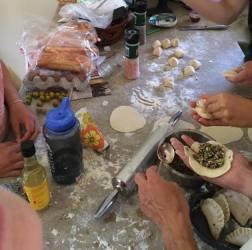 Folding in the dumpling filling