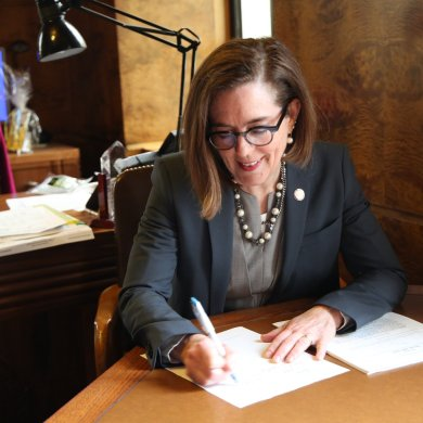 Gov Kate Brown of Oregon signs legislation for education funding into law