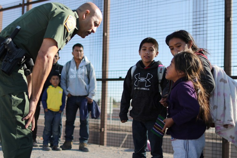 A group of Central American migrants is questioned about their children's health after surrendering to U.S. Border Patrol Agents south of the U.S.-Mexico border fence in El Paso, Texas, U.S., March 6, 2019. REUTERS/Lucy Nicholson