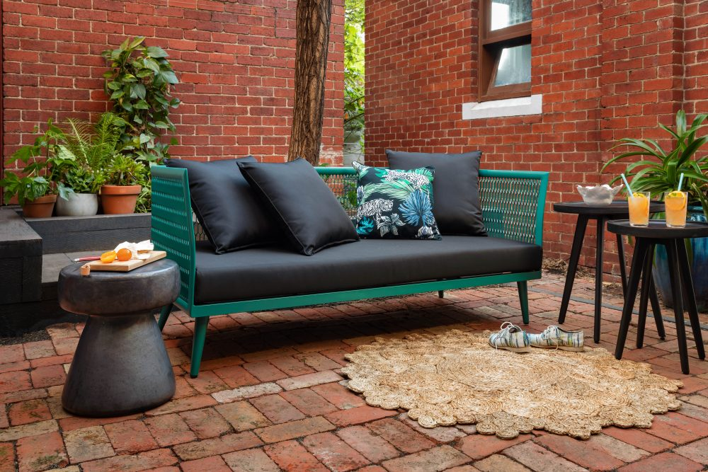 Alfresco entertaining with edge on the Poppy sofa