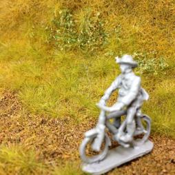 2 x KNIL infantryman riding bycycle with rifle in bush hat