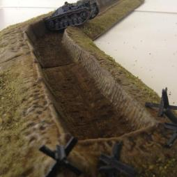 Anti-Tank Ditch with Revetted banks and 4 Anti-tank obstacles