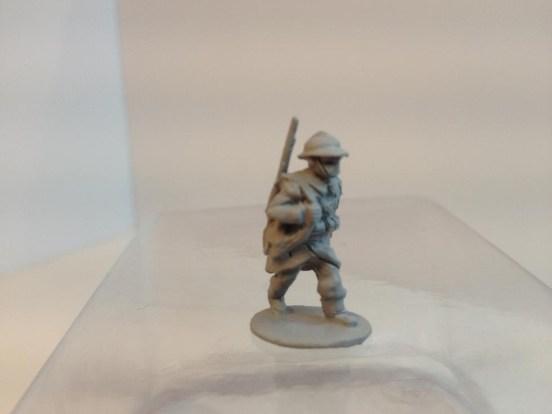3 x Infantryman -  Advancing rifle Slung, webbing and helmet.