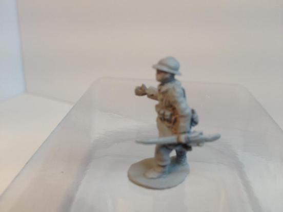 NCO/junior leader carrying rifle waving men forward