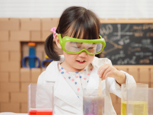 child doing early years science experiment. understanding the world, EYFS, childrens subscription box