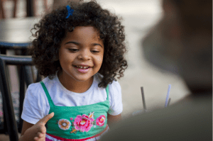 child smiling talking communication and language early years foundation stage eyfs