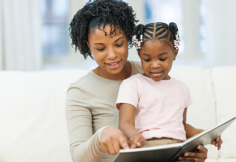 woman reading to child