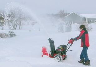 boy pushing snowblower