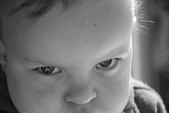 black and white picture of boy glaring at camera