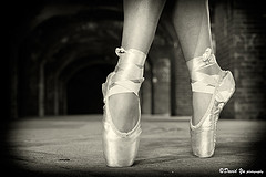 close up of ballerina's feet in toe shoes