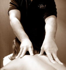 masseuse working on woman's back